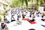 PARTICIPANTS PERFORMING YOGIC EXERCISE DURING HAPPINESS PROGRAMME CONDUCTED BY THE ART OF LIVING, ON 21ST JUNE, 2018 AT DST PREMISES
