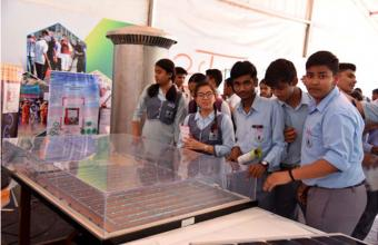 Students of Navyug School, New Delhi, with a Model of Shallow Emitter Silicon Solar  Cell displayed in the Exhibition during Swachhta Pakhwada