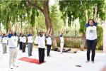 PARTICIPANTS DOING YOGIC EXERCISES ON 21ST JUNE, 2018 AT DST PREMISES